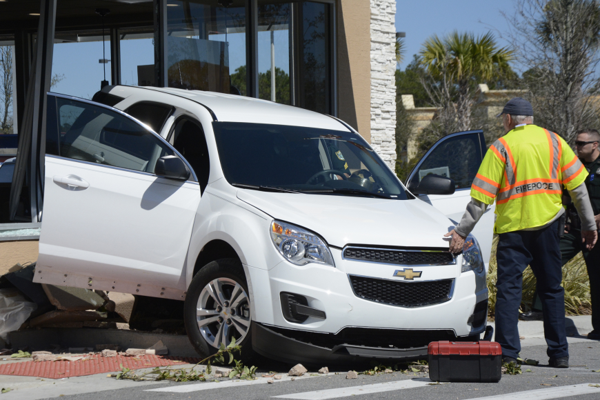 At around 12:30 p.m. on Sunday, Feb. 28, a white Chevrolet crashed into the McDonald's at the intersection of Palm Coast Parkway and Belle Terre Parkway. Photos by Anastasia Pagello