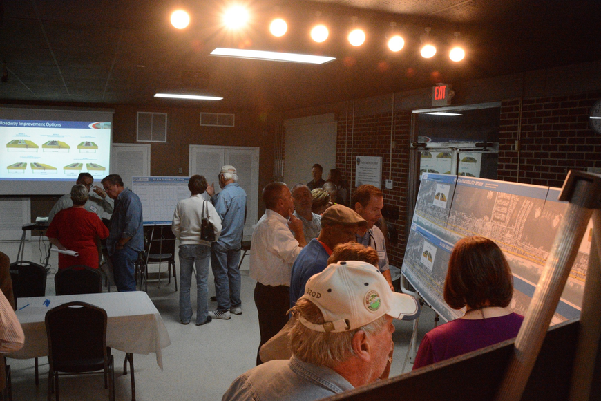 Attendees view exhibits during an open-house style meeting by FDOT at the Flagler Beach City Hall on potential permanent repairs for State Road A1A. (Photo by Jonathan Simmons)