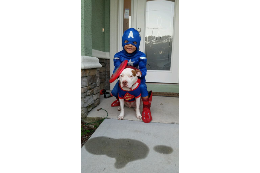 Jayden and the family dog, Muneco, both dressed up for Halloween. (Photo courtesy of the Puerta family)