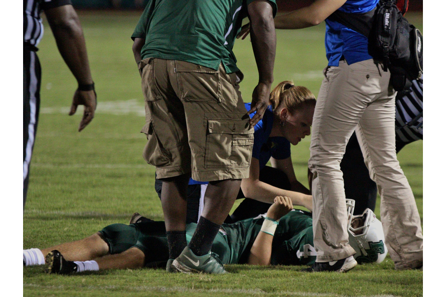 Flagler Palm Coast's Ryan Dean lay motionless with a concussion during the Bulldogs game against Mainland last season. Photos by Jeff Dawsey