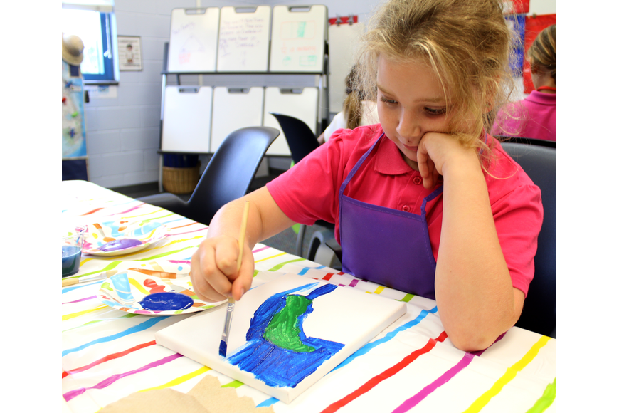 Ava Henige paints the state of Florida  in Dawn Emling's second-grade class at Belle Terre Elementary. Photo by Jacque Estes