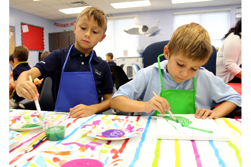 Aiden Asseo and Alex Berenblit paint the State of Florida as part of the class Nifty 50 year-long project. Photo by Jacque Estes