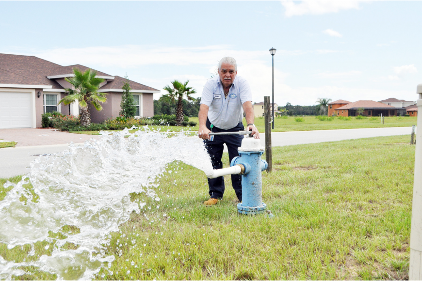 Gene McAdams, water quality lead technician for the city of Palm Coast, flushes a hydrant in Tuscana, in Hidden Lakes. Because there are many empty lots there, water usage is low in the area, McAdams said. PHOTO BY SHANNA FORTIER