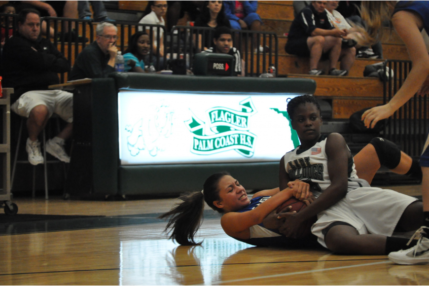 Flagler Palm Coast point guard Armani Walker (right) attempts to steal the ball Saturday night. FPC won the game, 54-36, to improve to 5-1 this season.