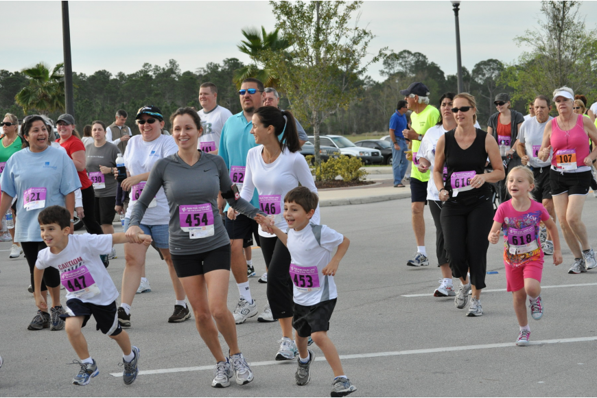 Nikki Gazzoli gets dragged by Nicholas Ferrer, 6, and Andrew Gazzoli, 6, Saturday, March 5 at the Race for Your Life 5K/10K sponsored by the Palm Coast Chamber of Commerce. PHOTOS BY SHANNA FORTIER