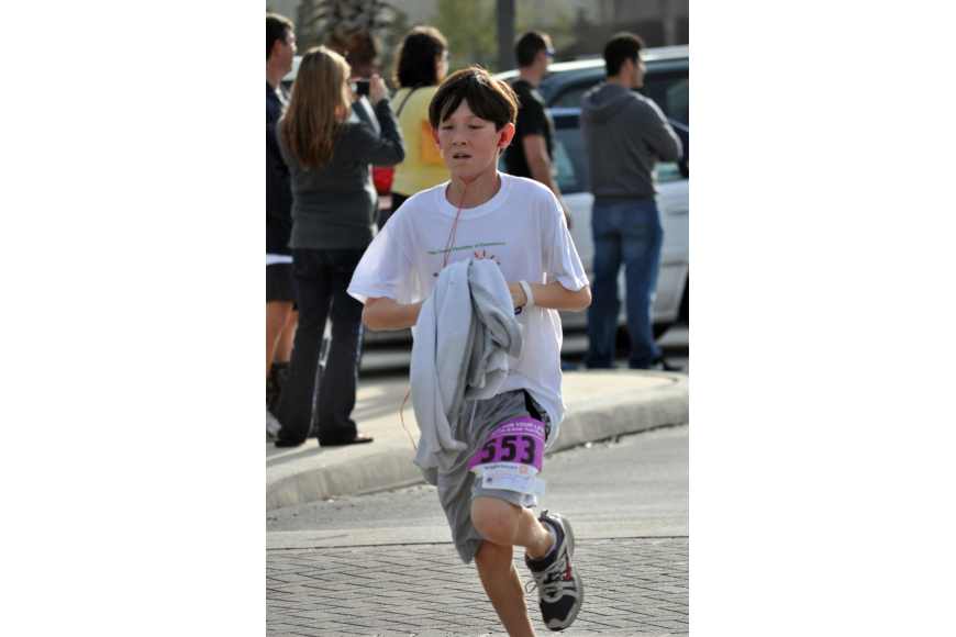 Fletcher Subers, 13, finished the 5K in 24 minutes and 36 seconds, second in his age range.