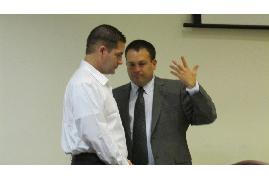 Lonnie Redner and his attorney, Bradley Sherman during Redner's trial. File photo.
