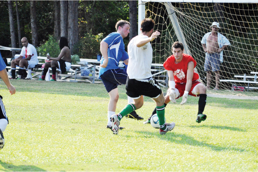 Greg Savy, of the Flagler Dawgs, blocks a shot in the semifinals May 4 against Black Lions in the Beaches Adult Soccer League 7v7 league.