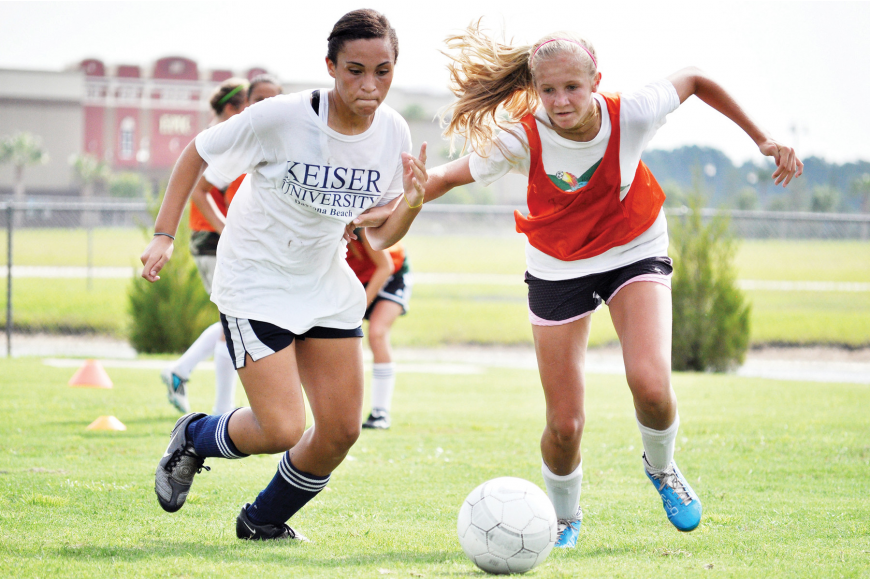 Chasity Vigo and Cara Warren battle for the ball during a one-on-one drill Tuesday morning at the Go To Goal soccer camp, hosted by Pete Hald, head coach of the Flagler Palm Coast Lady Bulldogs soccer team.