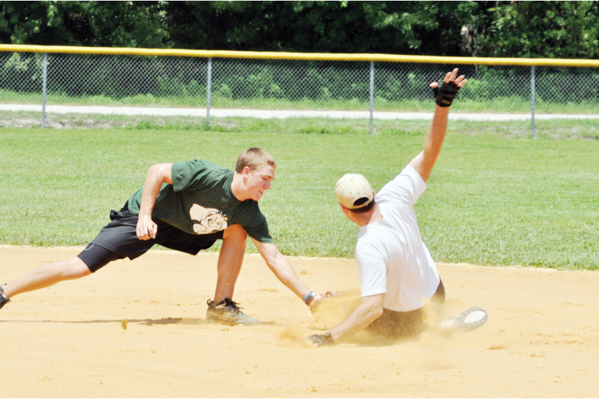Joe O'Brien, shortstop for Fox Landscaping, tags out Rod Long, of Flagler Coed, at second base, in the FPC softball fundraiser.