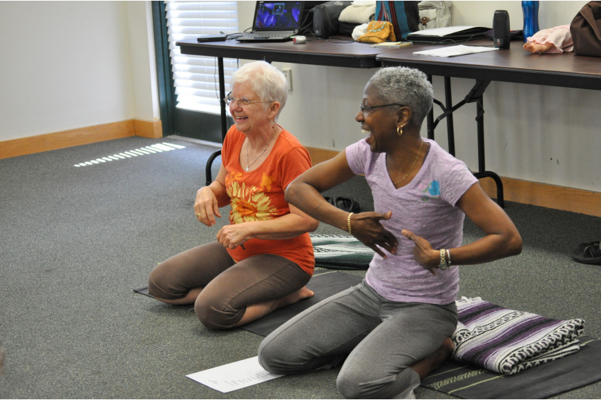 Micki Higgins and Beverly Chandler, of Padma Yoga, instruct the class.