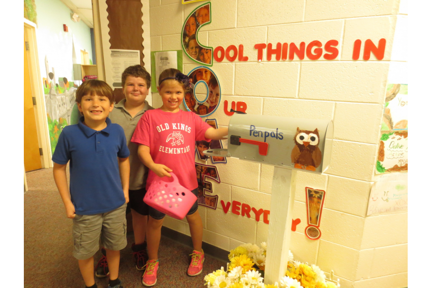 Dickinson and Sperber have matching mailboxes outside their classrooms, where students deliver the mail.