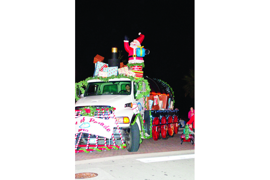 The city of Palm Coast's Santa Express rolls down the streets of Town Center.