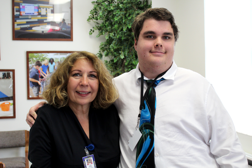 Daniel Schmidt, a student in the TRAIL Transition program, and Janet Nickels, the program manager for Flagler County Human Services. Photo by Jacque Estes