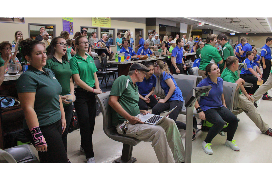 The section that Palm Coast Lanes has designated for the Flagler Palm Coast and Matanzas match has become an overcrowded, blue and green, loud showground